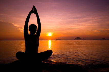 woman meditating in sunset
