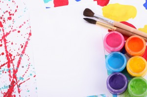 paint brush, paints, and paper
