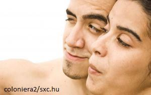 girl and guy with faces together