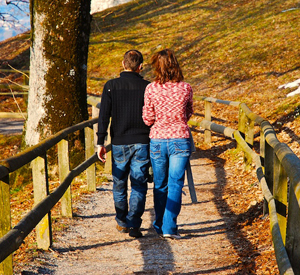 couple walking on a bridge