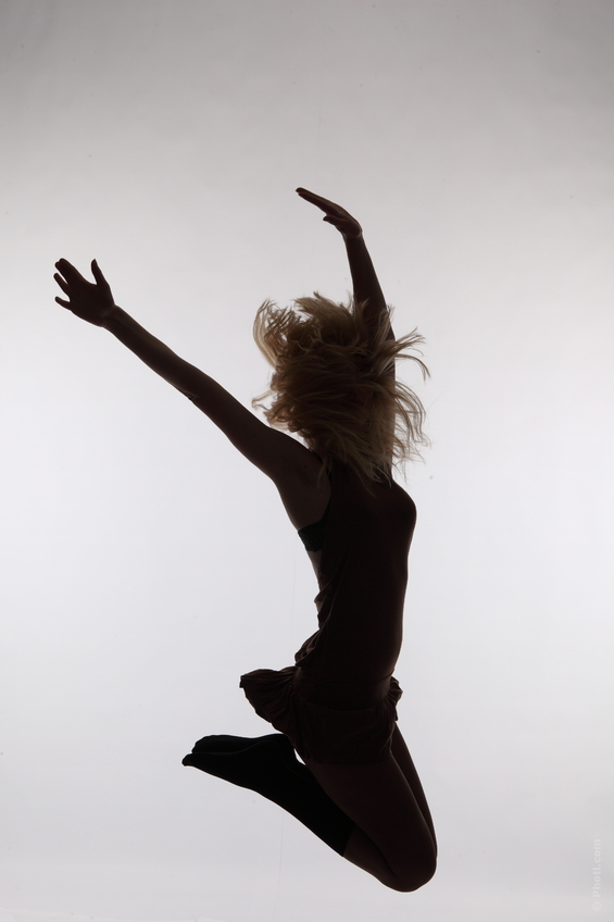 silhouette of woman jumping in air