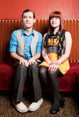 Awkward couple sitting down