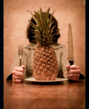 Dinner plate with raw pineapple