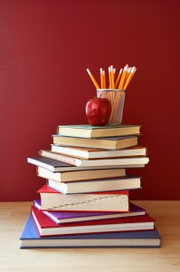 an apple, pencils, and books