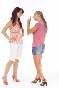 Two women frowning at each other