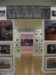 A hallway with photos of art