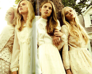 4 females in a countryside wearing pastel dresses
