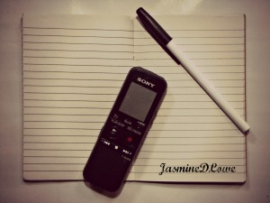 A notebook, a pen and a cellphone