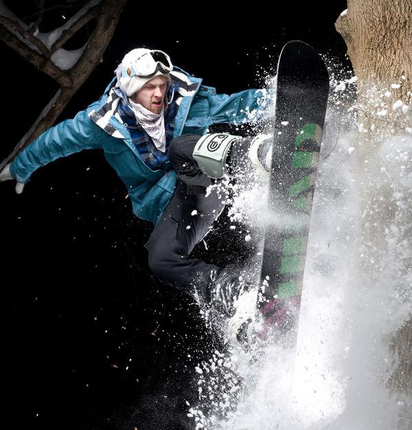 a man on a snowboard at night