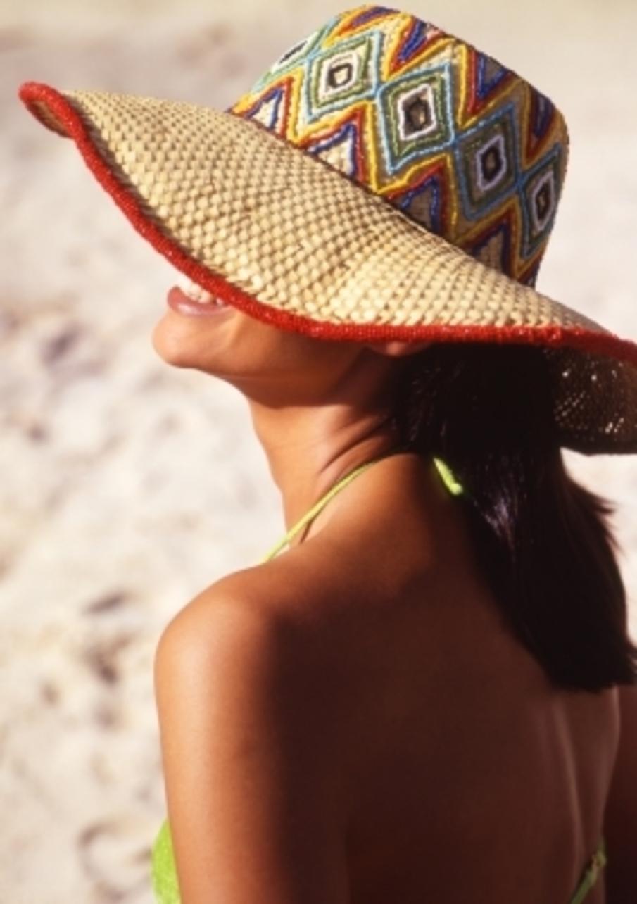 woman tanning on a sunny beach