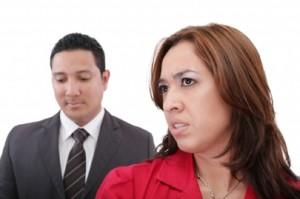 a man stands behind a woman