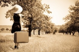 11147919-lonely-girl-with-suitcase-at-countryside