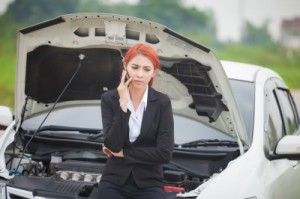 Woman by car on the phone