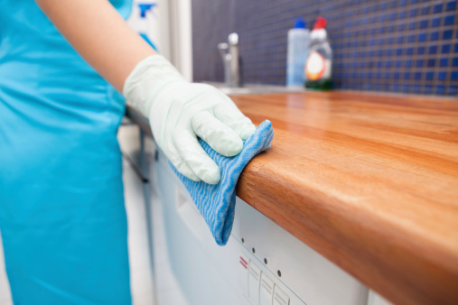 hand cleaning kitchen counter