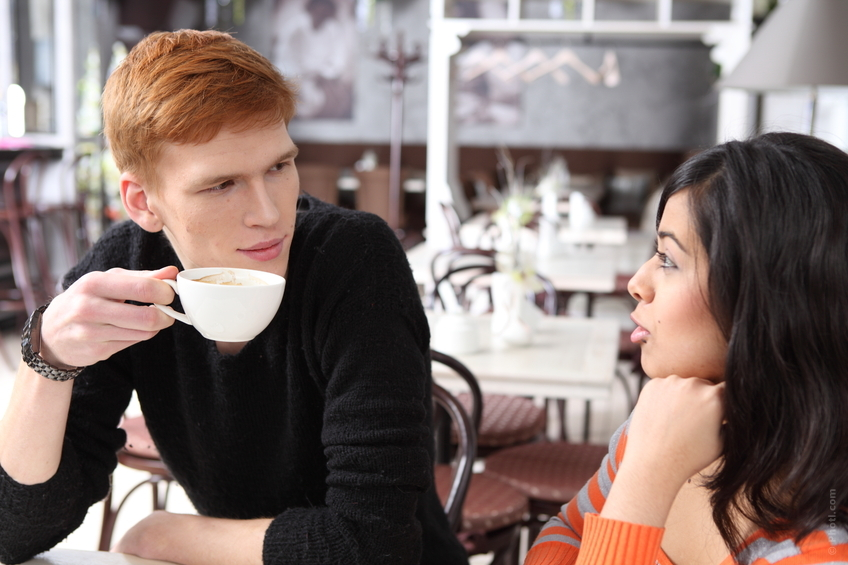 man and woman having a coffee date