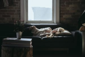 woman laying on a couch