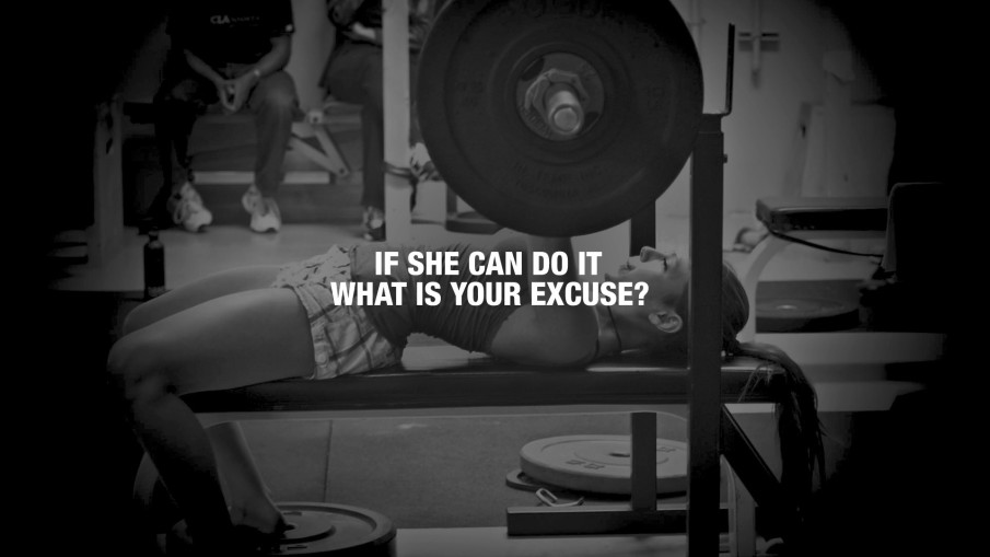 """woman bench-pressing heavy weights behind the text """"If she can do it what is your excuse?"""""""