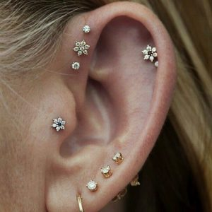 girl's ear piercings to reinvent her look