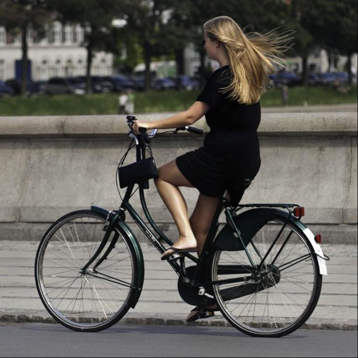 healthy woman riding a bike