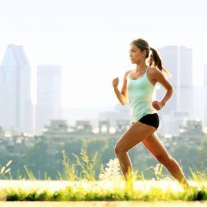 woman running on the grass