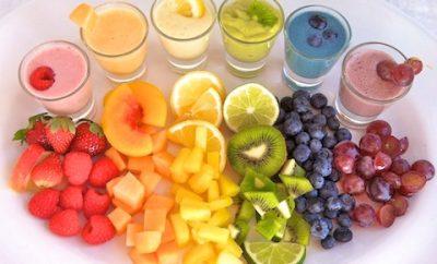 rainbow array of smoothies