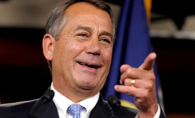 speaker of the house john boehner pointing and laughing