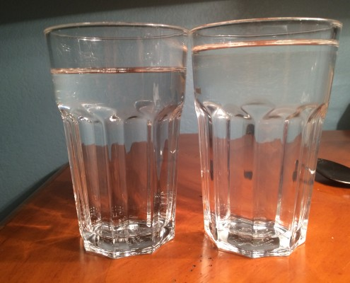two cups of water on a table
