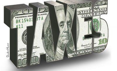 taxes word art in 100 dollar bill