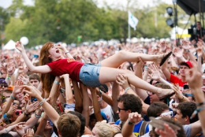 summer music festival girl crowd surfing
