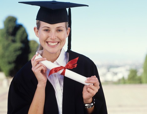 Girl with diploma in graduation gown