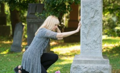 Woman grieving after death of a loved one