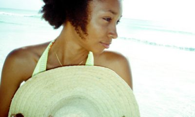 black woman on the beach with curly hair