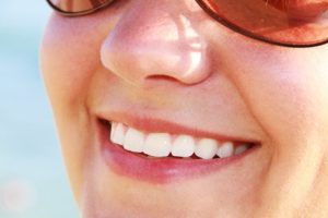 woman in sun glasses smiling