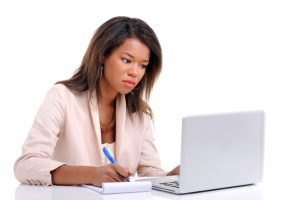 woman working on laptop for salary