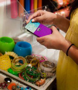 girl with cardninja buying bracelets