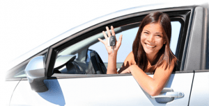 woman in her car showing off keys