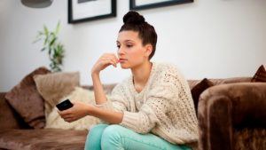 woman patiently waiting on couch