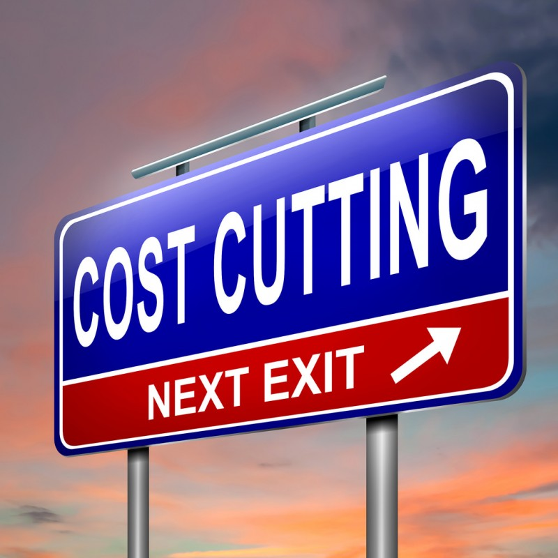 sign saying cost cutting, next exit to show ways to be wealthy in your 20s