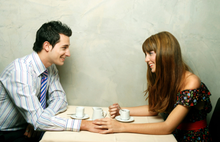 dating couple with coffee at table