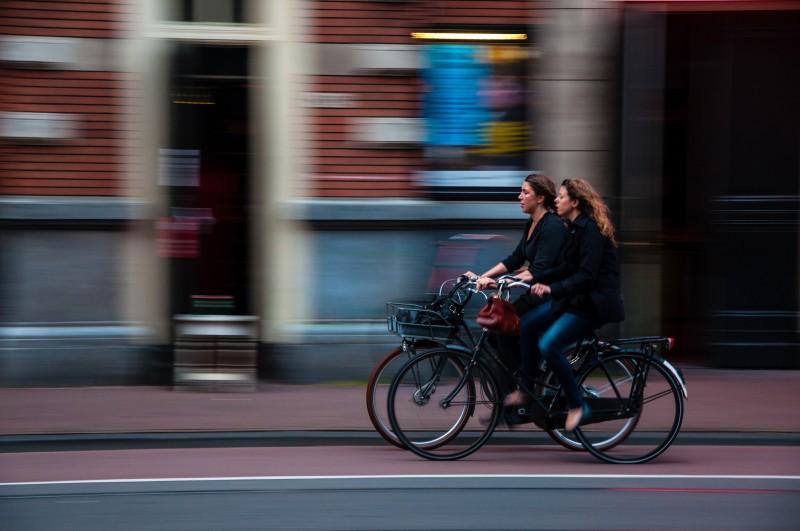 women cycling through town