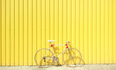 bike against yellow wall
