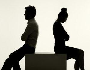couple sitting back to back arguing