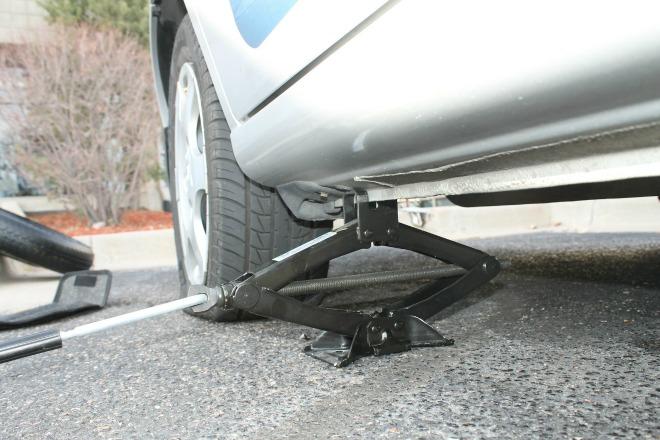 change a tire with a scissor jack