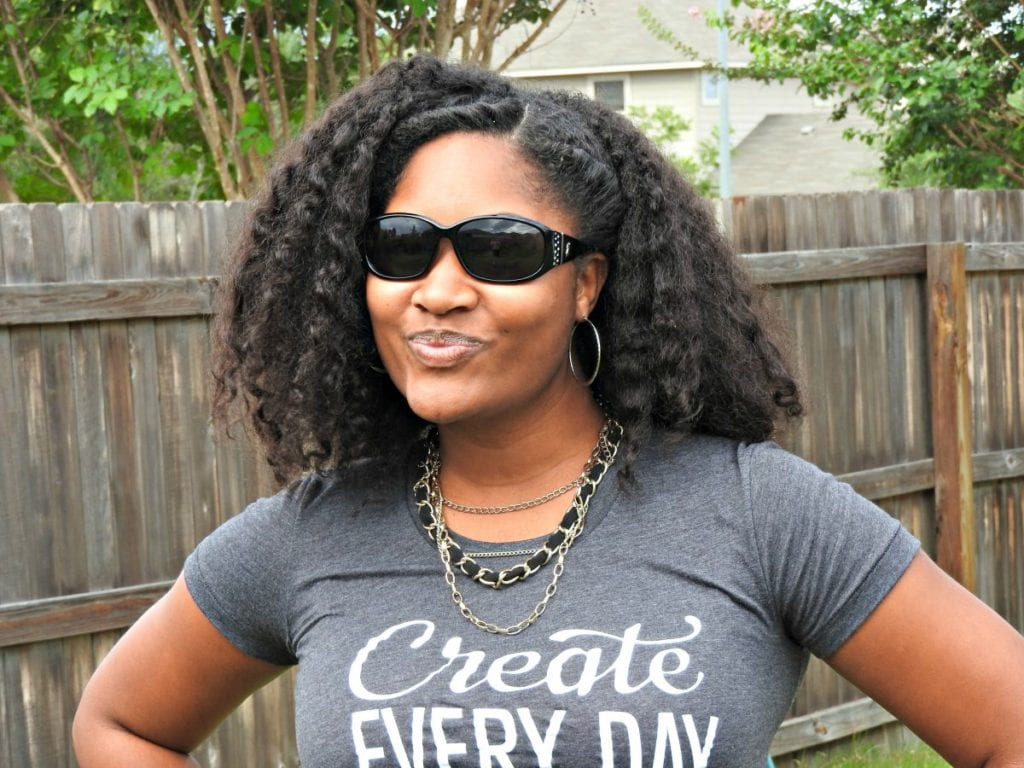 Jasmine Watts smiling with her sunglasses on