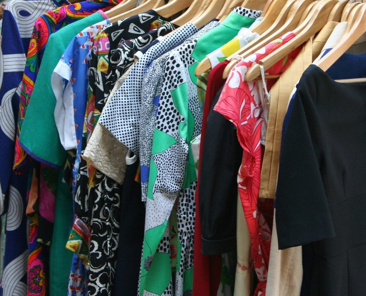 closeup of dresses on hangers