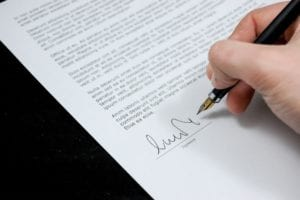 signing a contract for renting an apartment