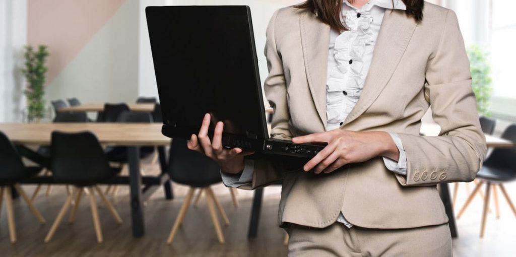 businesswoman holding laptop