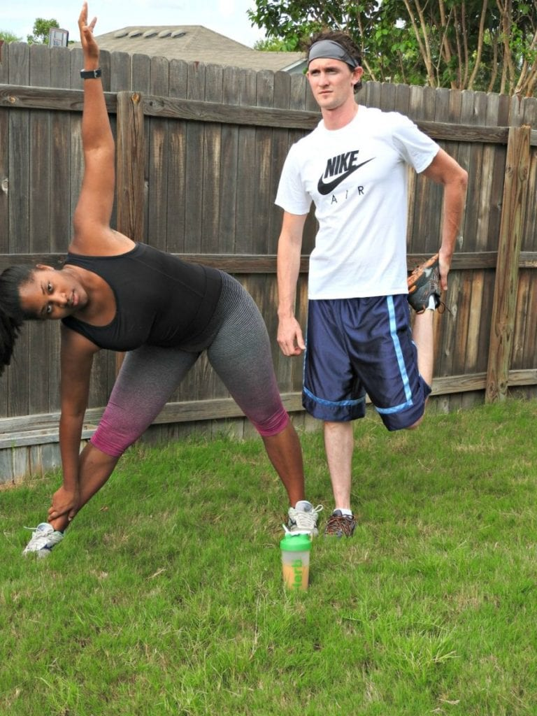 girl and guy stretching before exercise