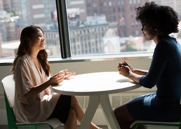 women talking by window