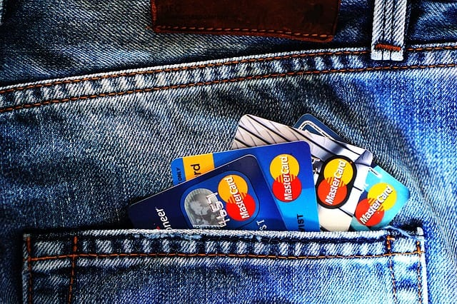 four credit cards in pocket of jeans